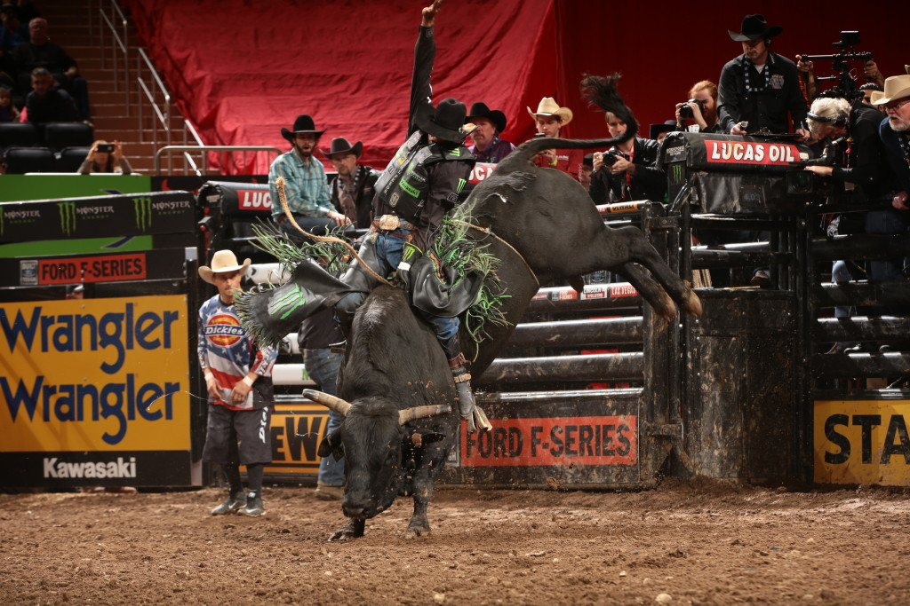 JB Mauney rides E-J Bucking Bulls, LLC/Gene Owen's Shaft for 89.25 during the championship round of the New York City Built Ford Tough series PBR. Photo by Andy Watson